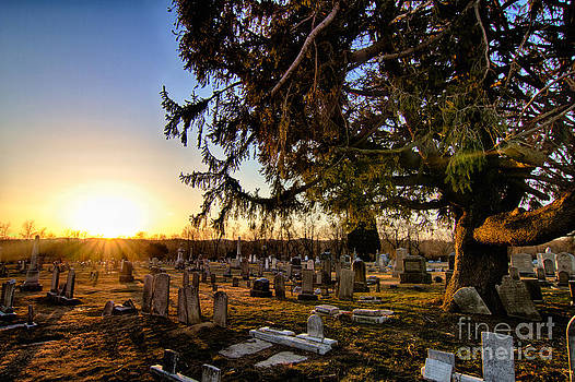 Sunset at the cemetery by Robert Wirth