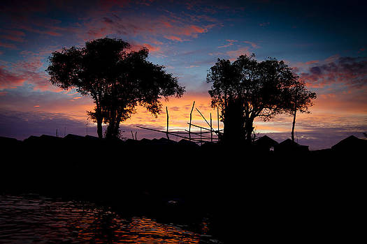 Sunset at the lake with trees by Thomas Pfeller