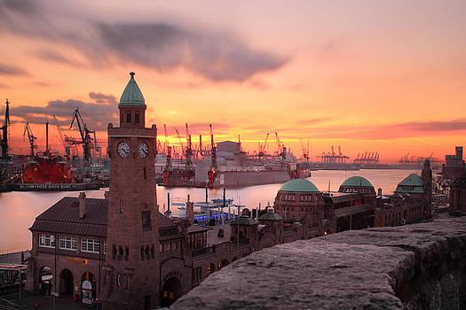 Sunset at the port of Hamburg by Marc Huebner