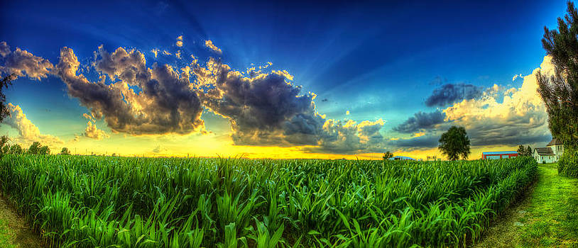 Sunset behind the clouds by  Caleb McGinn