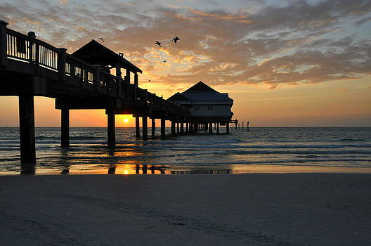 Sunset by the Pier by Tanis Crooks