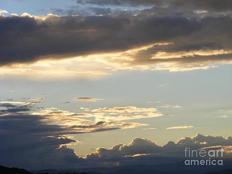 Sunset clouds by Helena Marais