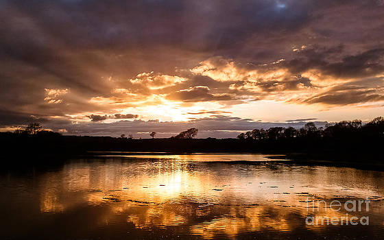 Sunset Madness at Carew Castle by Corinne Johnston