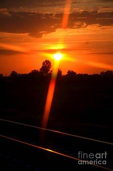 Sunset of a sun above per rail by Leonid Nozdrachov