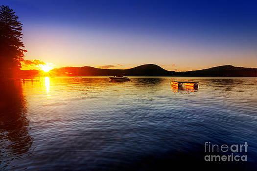 Jo Ann Snover - Sunset over calm lake