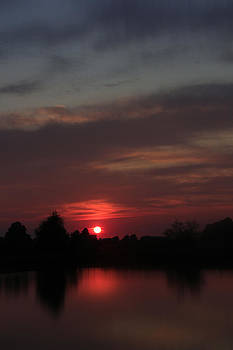 Sunset over small pond in the midwest Indiana by Bailey and Huddleston
