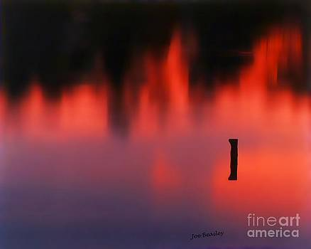 Sunset Reflected in a Pond by   Joe Beasley