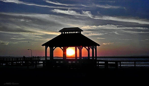 Sunset scene thru Gazebo by Mikki Cucuzzo