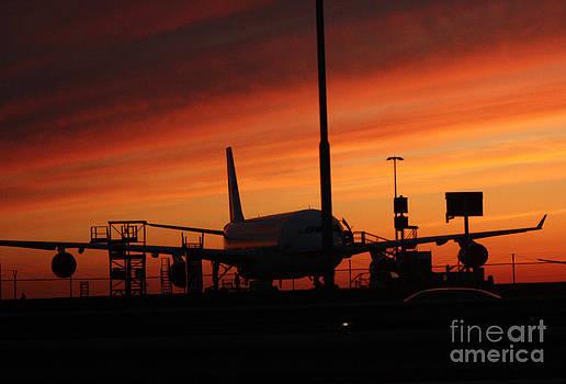 Sunset. Vulcanic ash cloud closing down airport by Sara  Meijer