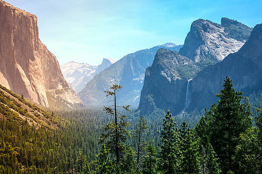 Sunset's golden light moves across Yosemite Valley's waterfalls by Laura Palmer
