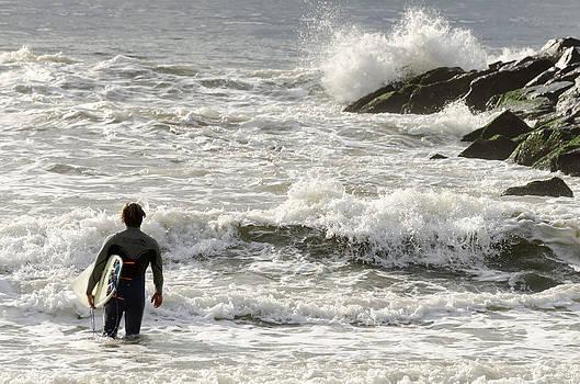 Surfer Heading Out Rockaway Beach by Maureen E Ritter