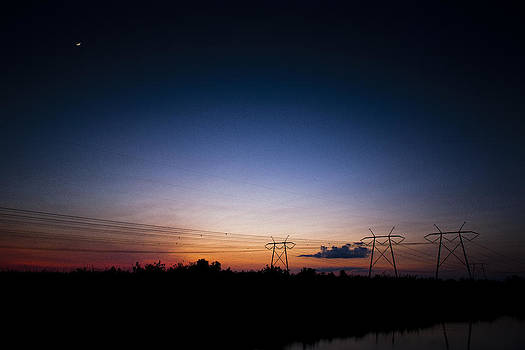 Sunset And Moonrise Over Everglades by Bradley R Youngberg