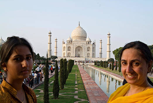 Devinder Sangha - Taj Mahal framed by two females