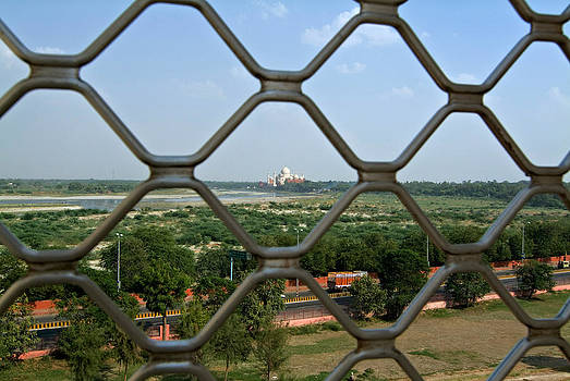 Devinder Sangha - Taj Mahal through Agra fort fence