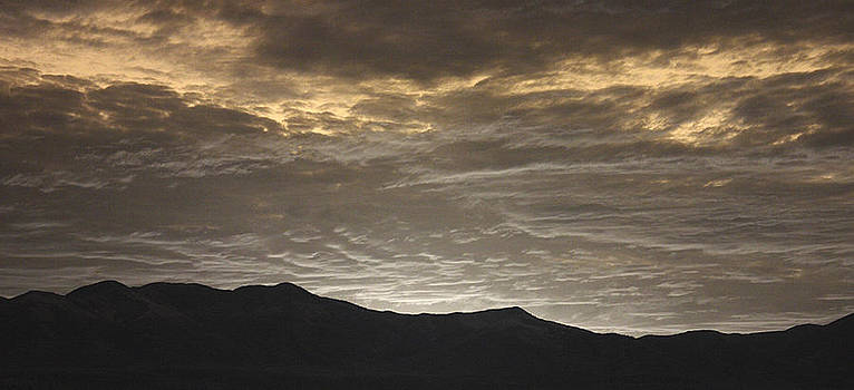 Taos Sunrise by T R Maines