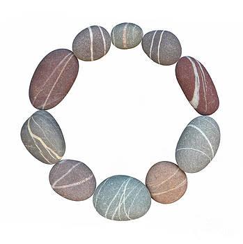 Ten granite pebbles forming circle by Rosemary Calvert