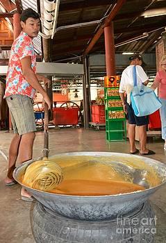 Thai guys making sugar candy   by Bobby Mandal