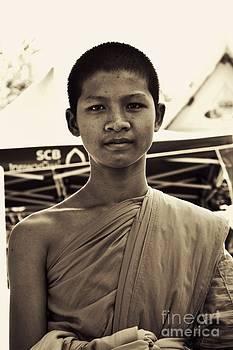 Thai teen monk  by Bobby Mandal