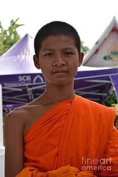 Thai teenage monk  by Bobby Mandal