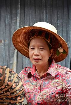 Thai women with traditional hat by Bobby Mandal