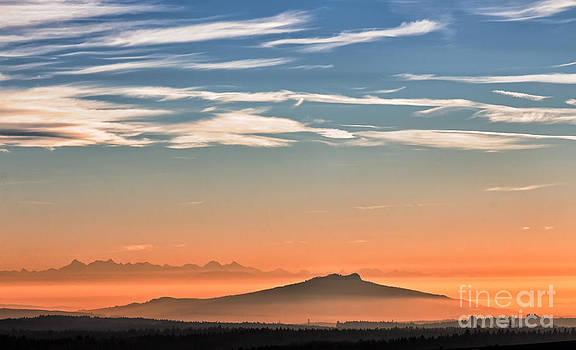 The Alps Sunset over fog by Bernd Laeschke