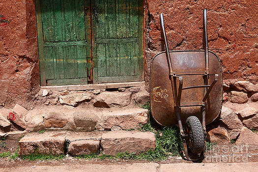 James Brunker - Rusty Wheelbarrow and Green Door
