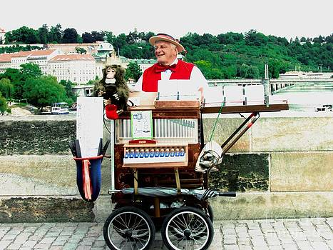 The Organ Grinder and his Monkey on the Charles Bridge by Freda Sbordoni