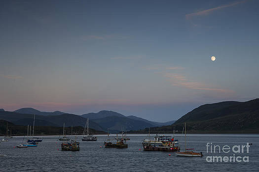 The Sun sets and the Moon rises on Loch Broom by Howard Kennedy