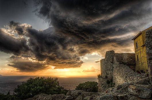 The sunset storm over the castle by Tommaso Di Donato