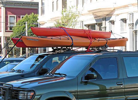 Connie Fox - Three Orange Kayaks
