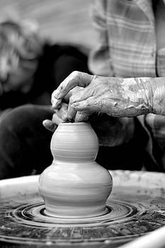 Throwing on the Pottery Wheel by Megan Luschen