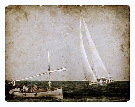 Pedro Cardona Llambias - Time at sea as old times - A vintage mediterranean boat called llaud and a modern sailboat salutes