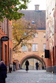 Timeless Swedish scene - old buildings - cobbled streets - cyclist - Uppsala - Sweden by David Hill