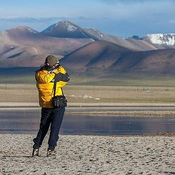 Tourist At Namtso by Hitendra SINKAR