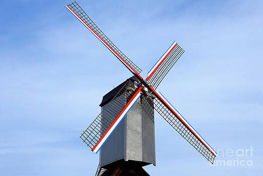 Traditional old windmill in Belgium by Kiril Stanchev