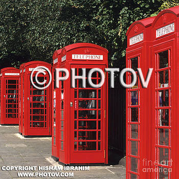 Traditional red telephone boxes - London - England by Hisham Ibrahim