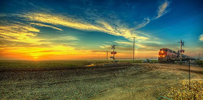 Train sunrise by  Caleb McGinn