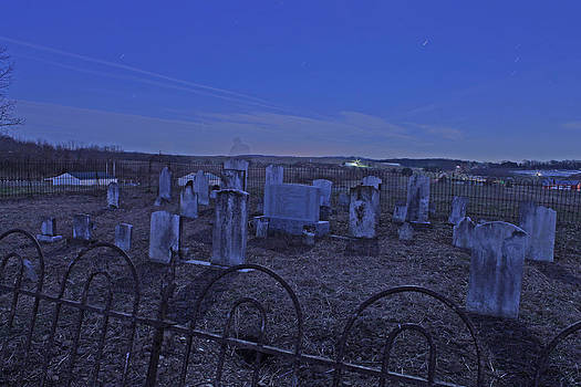 Trapped in an abandoned cemetery by Rick Weiberg