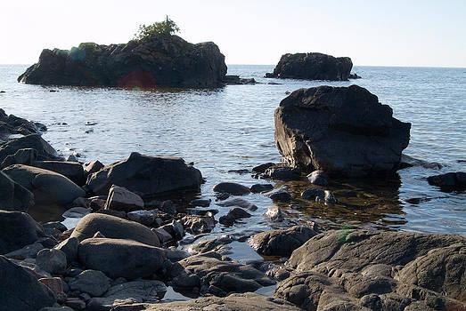 Devinder Sangha - Trio of Rocks in Lake