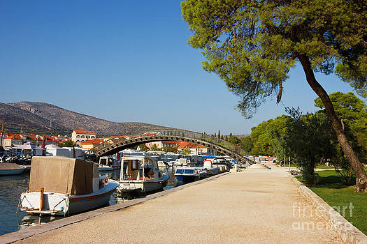 Trogir Waterfront with boats lined along the coast by Kiril Stanchev