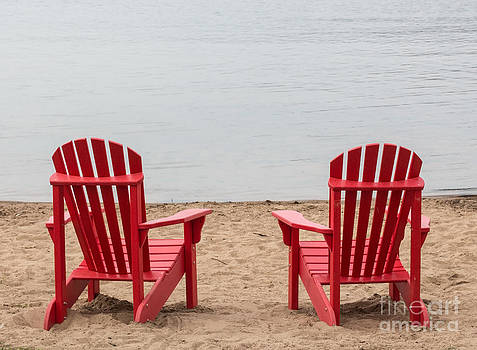 Barbara McMahon - Two Red Adirondack Chairs