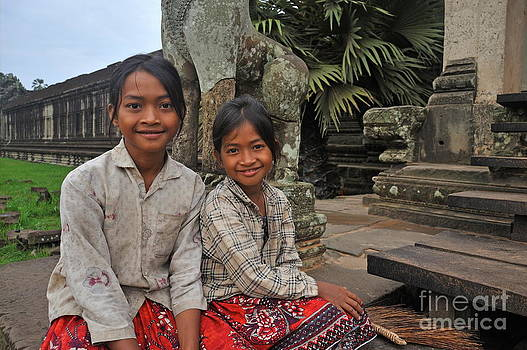 Two young cambodian girls in Angkor Wat by Sami Sarkis