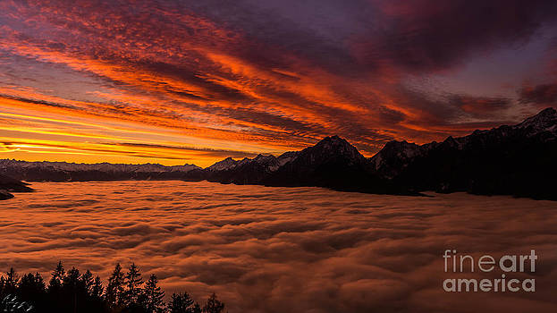 Under above the clouds by Florian Mauerhofer