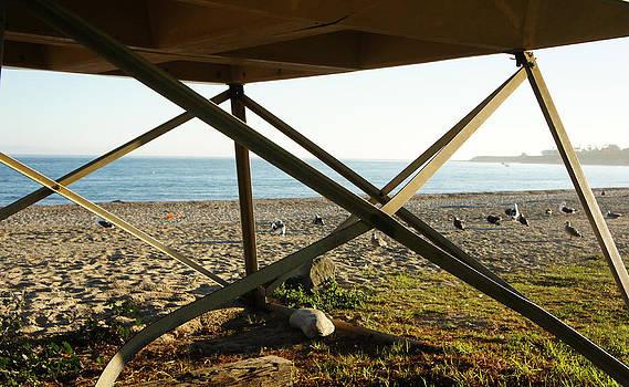 Underneath Lifeguard Post on the Beach by Nadra Raquel