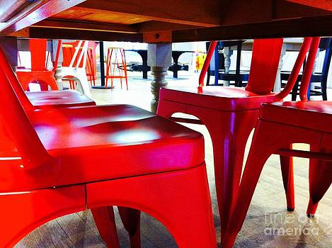 Underneath the table red chairs by WaLdEmAr BoRrErO