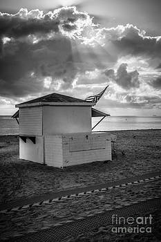 Ian Monk - US Flag on Beach Hut illuminated by early morning sun - Black and White