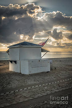 Ian Monk - US Flag on Beach Hut illuminated by early morning sun