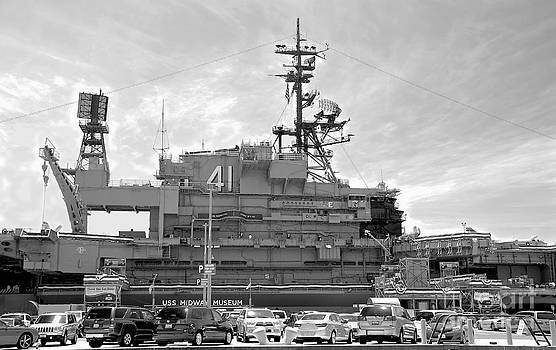 Uss MIDWAY MUSEUM CV 41 Aircraft carrier - from parking lot view - Black and White by Claudia Ellis