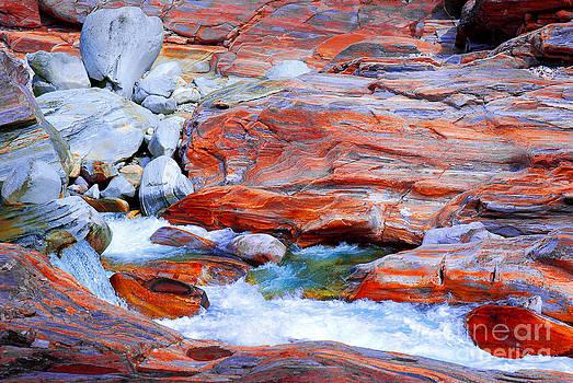 Vibrant colored rocks Verzasca Valley Switzerland by Lilianna Sokolowska