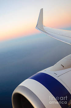 View from a plane - beautiful sunset over the Pacific Ocean by David Hill